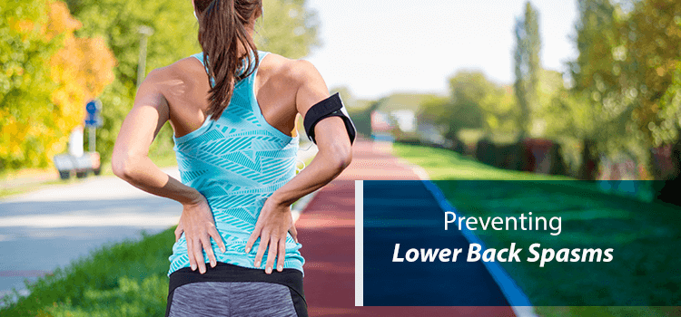 woman with back spasms running on track