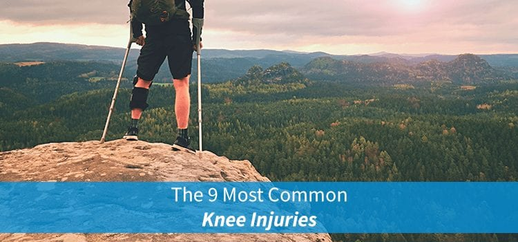 man with knee injury standing on mountain with crutches